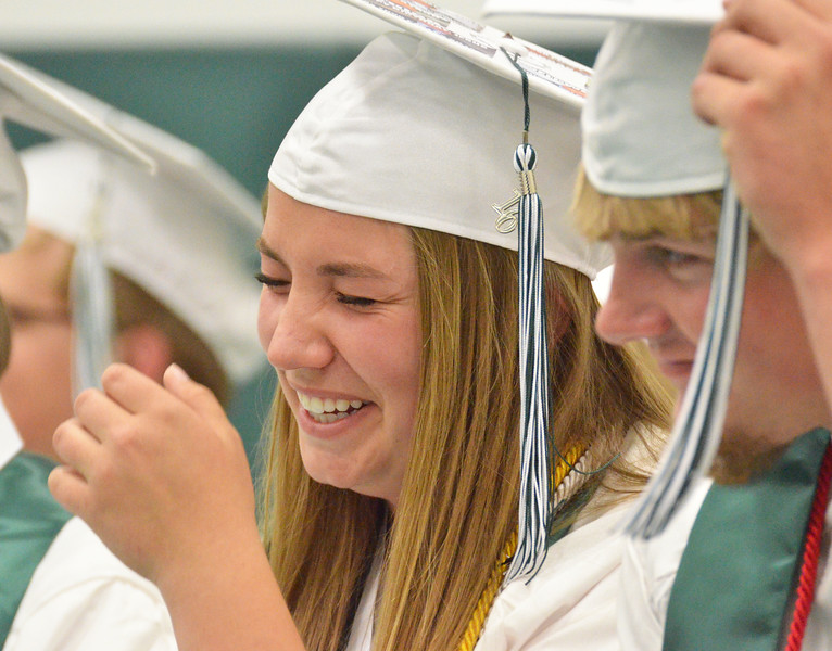 Mike Dunn | The Sheridan Press.<br /> Gracie Carr, left, laughs during the the keynote address at the commencement ceremony at Tongue River High School Sunday evening.