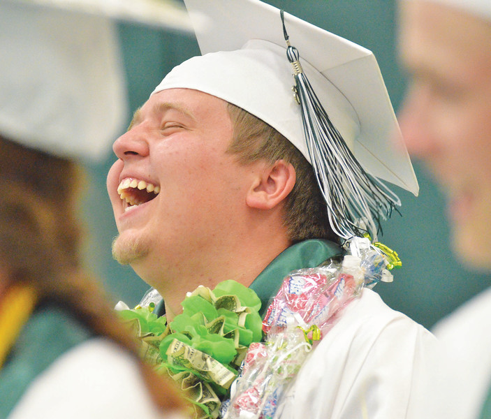 Mike Dunn | The Sheridan Press. <br /> Dylan Patterson laughs during the commencement ceremony at Tongue River High School Sunday evening.