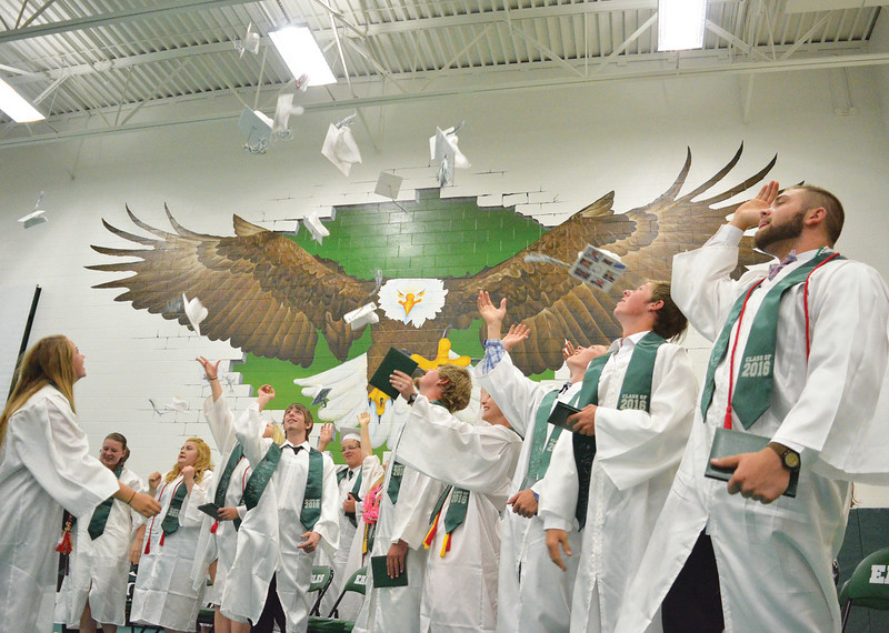 Mike Dunn | The Sheridan Press. <br /> Tongue River graduates throw their caps into the air at the Tongue River High School commencement ceremony Sunday.