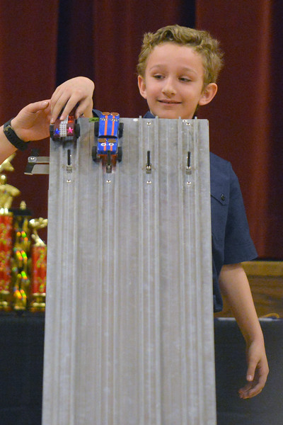Shaun Gonda places his car in the starting position during the Boy Scouts Pack 510 pinewood derby on Saturday, March 4 at the Church of Jesus Christ of Latter Day Saints. Mike Pruden | The Sheridan Press