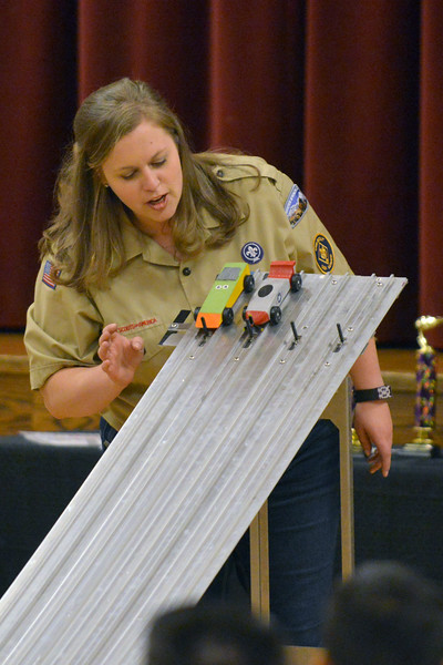 Ruth Humphrey sends two cars down the track during the Boy Scouts Pack 510 pinewood derby on Saturday, March 4 at the Church of Jesus Christ of Latter Day Saints. Mike Pruden | The Sheridan Press