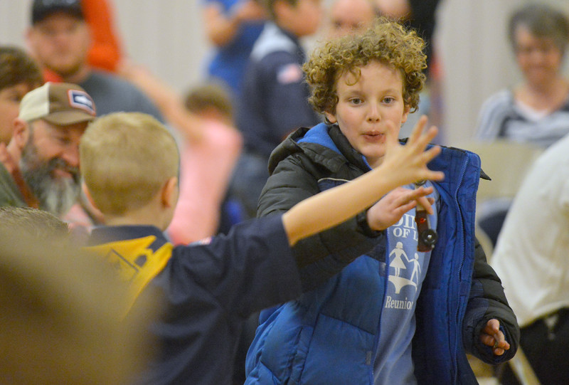 Camden Gonda gets a high-five from a spectator after a race at the Boy Scouts Pack 510 pinewood derby on Saturday, March 4 at the Church of Jesus Christ of Latter Day Saints. Mike Pruden | The Sheridan Press