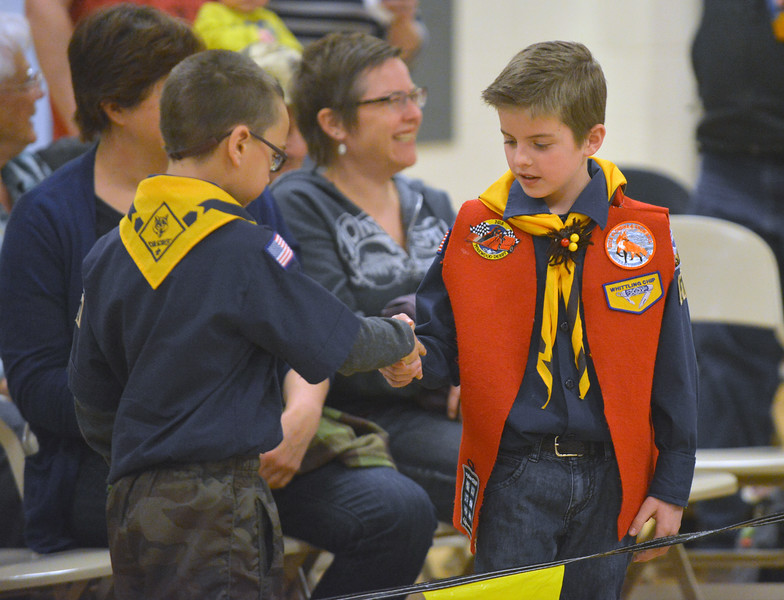 Zane Doyle, right, congratulates opponent Jr. Weimer after a race at the Boy Scouts Pack 510 pinewood derby on Saturday, March 4 at the Church of Jesus Christ of Latter Day Saints. Mike Pruden | The Sheridan Press