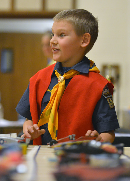 Michael Hodnett grabs his car from the pits before the start of a race during the Boy Scouts Pack 510 pinewood derby on Saturday, March 4 at the Church of Jesus Christ of Latter Day Saints. Mike Pruden | The Sheridan Press