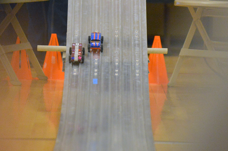 Two cars speed down the track during the Boy Scouts Pack 510 pinewood derby on Saturday, March 4 at the Church of Jesus Christ of Latter Day Saints. Mike Pruden | The Sheridan Press