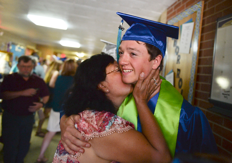 Justin Sheely | The Sheridan Press<br /> Graduate Jonathan Haugen is congratulated by loved ones during the 2017 Graduation Ceremony Saturday at Fort Mackenzie High School.