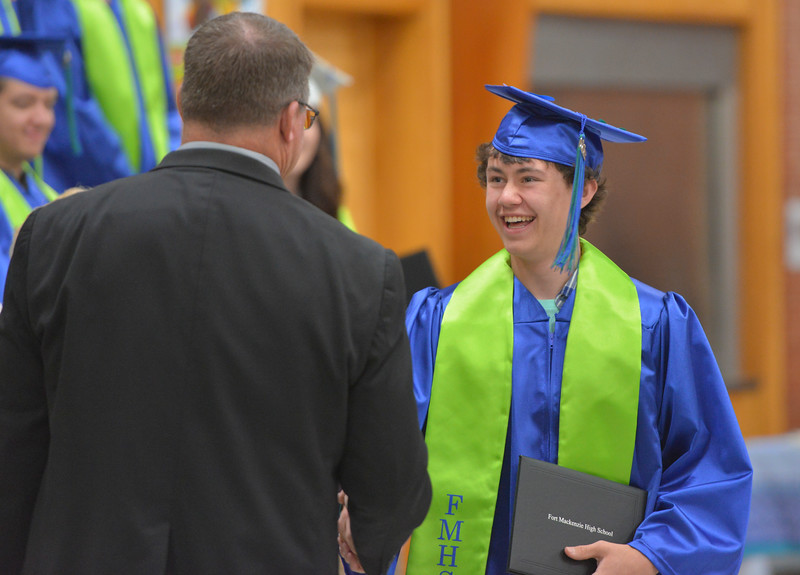 Justin Sheely | The Sheridan Press<br /> Cade Neeson shakes hands with principal Troy Lake after receiving his diploma during the 2017 Graduation Ceremony Saturday at Fort Mackenzie High School.