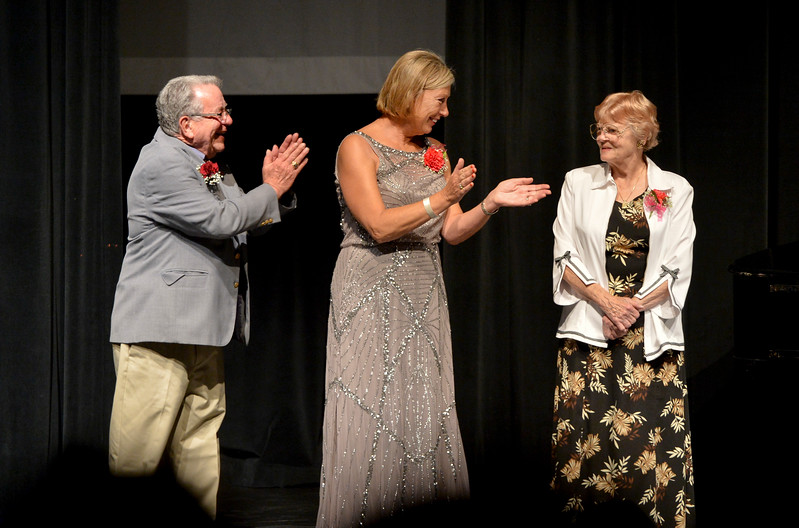 Justin Sheely | The Sheridan Press<br /> Honorees Jim Wilson, left, Jacomien Mars and Reta Onstott are recognized on stage during the annual Keystone Awards Thursday at the WYO Theater.