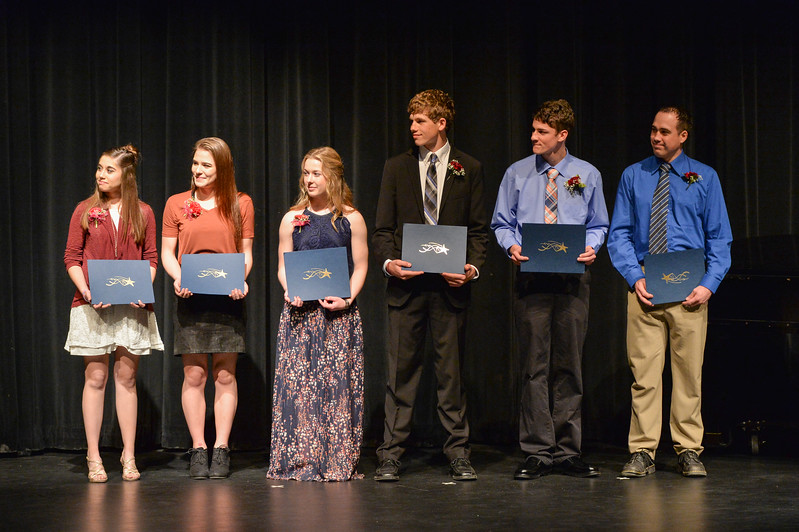 Justin Sheely | The Sheridan Press<br /> Students are presented with the 2017 Keys to the Stone honors on stage during the annual Keystone Awards Thursday at the WYO Theater. From left, Sierra McCoy of Tongue River High School, Whitney Migrants of Ft. MacKenzie High School, Kylar Klaasen of Arvada-Clearmont High School, Tanner Warder of Big Horn High School, Paden Koltiska of Sheridan High School and Frank Baca of Sheridan College.
