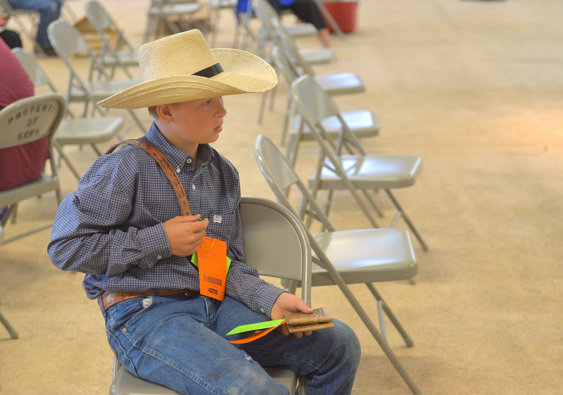 Justin Sheely | The Sheridan Press<br /> Ten-year-old Ricky Kelty waits to show his tooled leather items to the judge at the static exhibit during the Sheridan County Fair Tuesday at the Sheridan County Fairgrounds Exhibit Hall.