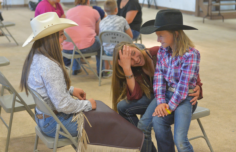 Justin Sheely | The Sheridan Press<br /> From left, Justine Moore-Bradley, 14, Kayce Pearce, 15, and Faith Van Dyke, 8, visit as they wait for the interviewing process of the static exhibit during the Sheridan County Fair Tuesday at the Sheridan County Fairgrounds Exhibit Hall.