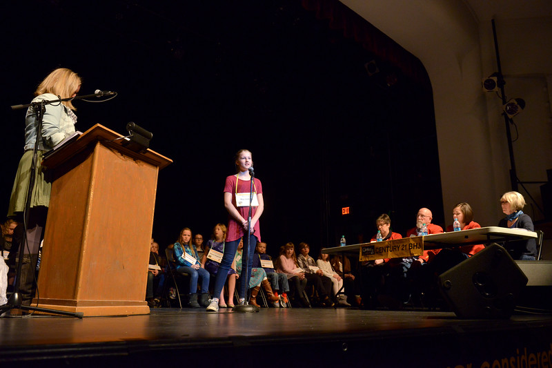 Justin Sheely | The Sheridan Press<br /> Elsa Lindberg spells out a word during the 2017 Sheridan County Spelling Bee hosted by Century 21 BHJ Realty Saturday at the WYO Theater.