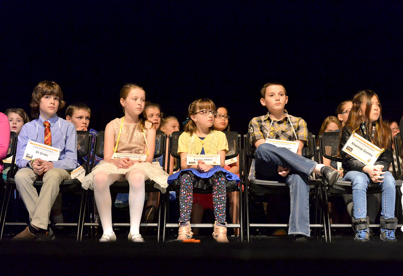 Justin Sheely | The Sheridan Press<br /> Contestants, from left, Eli Oaks, Cameron Cook, Kadia Miller, Jacob Sullivan and Kharma Gentry wait in their seats during the 2017 Sheridan County Spelling Bee hosted by Century 21 BHJ Realty Saturday at the WYO Theater.