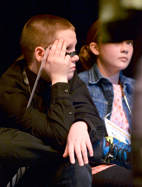 Justin Sheely | The Sheridan Press<br /> Coffeen Elementary student Grant Mulholland waits as another contestant answers during the 2017 Sheridan County Spelling Bee hosted by Century 21 BHJ Realty Saturday at the WYO Theater.
