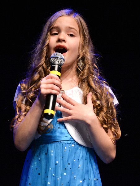 "Justin Sheely | The Sheridan Press<br /> Tess Bateman sings ""Almost There"" during the dress rehearsal for Stars of Tomorrow Thursday at the WYO Theater. The Sheridan Kiwanis Club talent contest is Friday, 7 p.m. at the WYO Theater."