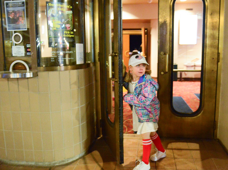Justin Sheely | The Sheridan Press<br /> Six-year-old Molly Sheeley holds the door open for her family during the dress rehearsal for Stars of Tomorrow Thursday at the WYO Theater. The Sheridan Kiwanis Club talent contest is Friday, 7 p.m. at the WYO Theater.