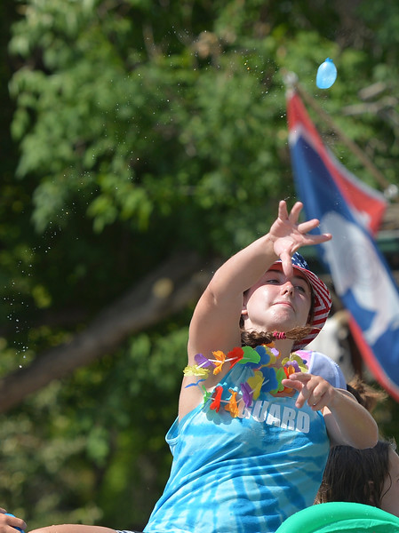 Justin Sheely | The Sheridan Press<br /> Jenna Keller throws a water balloon from the Dayton Pool float during the parade at the 40th annual Dayton Days Saturday in the town of Dayton. The upper-ninety-degree weather did not stop Tongue River Valley residents from enjoying the day's festivities, including knocker ball, human foosball, duck races and the firemen's water fight.