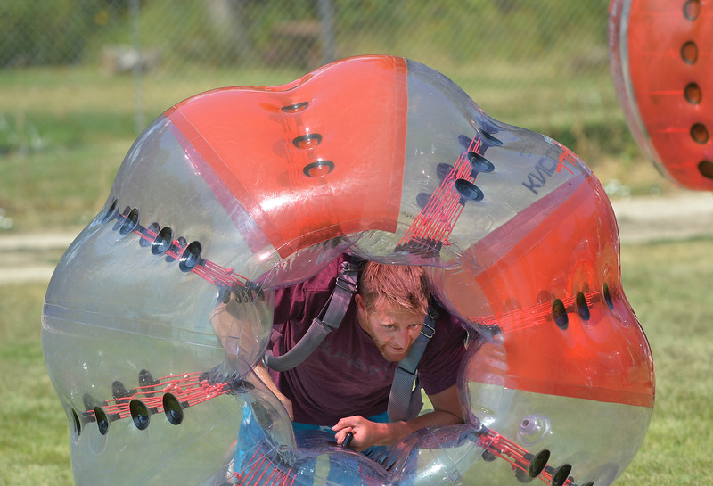Justin Sheely | The Sheridan Press<br /> Brady Lewis picks himself up inside his bubble ball for a game of knocker ball during the 40th annual Dayton Days Saturday in the town of Dayton. The upper-ninety-degree weather did not stop Tongue River Valley residents from enjoying the day's festivities, including knocker ball, human foosball, duck races and the firemen's water fight.