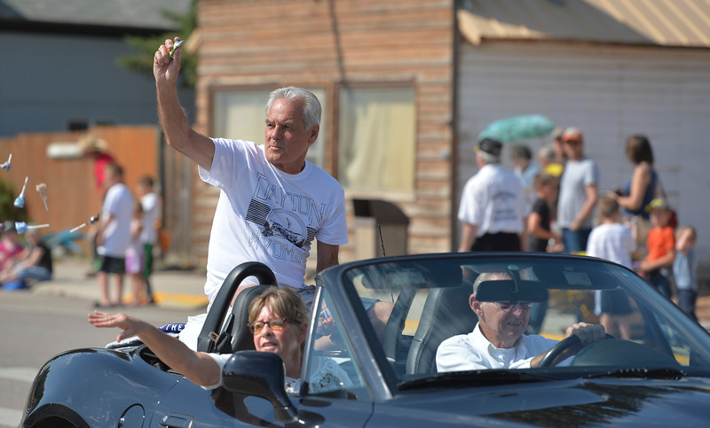 Justin Sheely | The Sheridan Press<br /> Parade grand marshall Johann Nield tosses candy from the car for the parade during the 40th annual Dayton Days Saturday in the town of Dayton. The upper-ninety-degree weather did not stop Tongue River Valley residents from enjoying the day's festivities, including knocker ball, human foosball, duck races and the firemen's water fight.