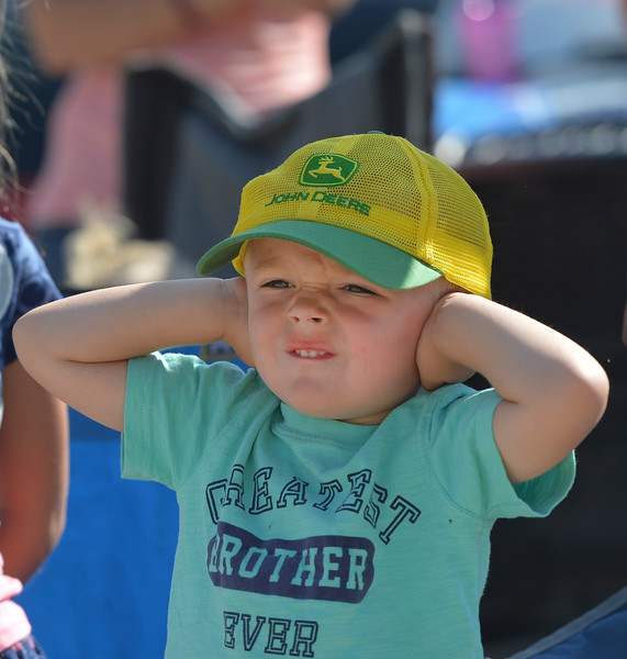 Justin Sheely | The Sheridan Press<br /> Three-year-old Jace Overturf holds his ears as emergency vehicles blaze their sirens for the parade during the 40th annual Dayton Days Saturday in the town of Dayton. The upper-ninety-degree weather did not stop Tongue River Valley residents from enjoying the day's festivities, including knocker ball, human foosball, duck races and the firemen's water fight.