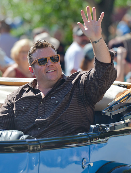 Justin Sheely | The Sheridan Press<br /> Adam Bartley – The Ferg – waves to fans during the Longmire Parade Friday in Buffalo. 2016 marks the 5th year of Longmire Days for the town of Buffalo, which hosted several events involving the cast and members of the crew to meet their fans. Longmire started out on cable television in 2012 and is now a series on Netflix. The show follows the exploits of Sheriff Walt Longmire in fictional Absaroka County, Wyoming. The series is from local author Craig Johnson's books, who based the fictional town in his books on Buffalo, Wyoming.