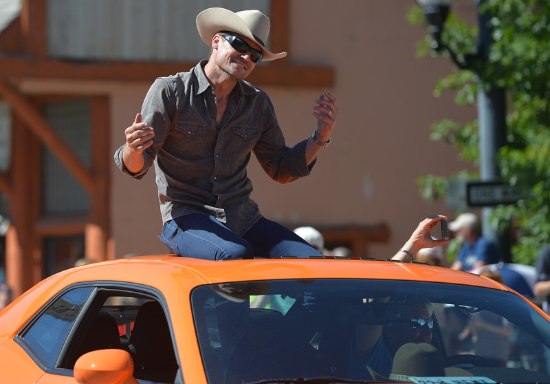 Justin Sheely | The Sheridan Press<br /> Bailey Chase – Branch Connally – greets the crowd during the Longmire Parade Friday in Buffalo. 2016 marks the 5th year of Longmire Days for the town of Buffalo, which hosted several events involving the cast and members of the crew to meet their fans. Longmire started out on cable television in 2012 and is now a series on Netflix. The show follows the exploits of Sheriff Walt Longmire in fictional Absaroka County, Wyoming. The series is from local author Craig Johnson's books, who based the fictional town in his books on Buffalo, Wyoming.