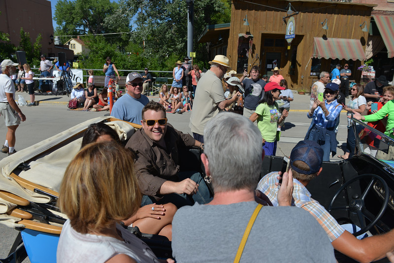 Justin Sheely | The Sheridan Press<br /> Fans greet Adam Bartley – The Ferg – during the Longmire Parade Friday in Buffalo. 2016 marks the 5th year of Longmire Days for the town of Buffalo, which hosted several events involving the cast and members of the crew to meet their fans. Longmire started out on cable television in 2012 and is now a series on Netflix. The show follows the exploits of Sheriff Walt Longmire in fictional Absaroka County, Wyoming. The series is from local author Craig Johnson's books, who based the fictional town in his books on Buffalo, Wyoming.
