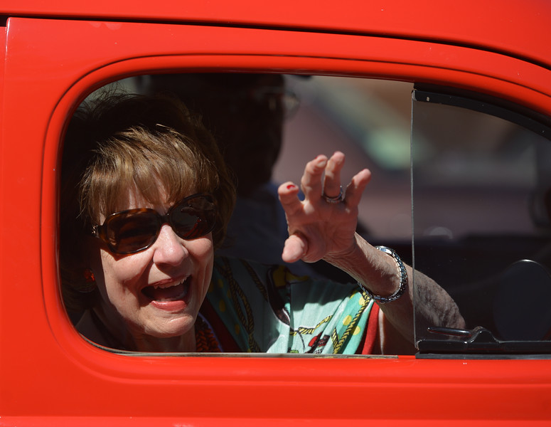 Justin Sheely | The Sheridan Press<br /> Louanne Stephens – Ruby – waves to the fans during the Longmire Parade Friday in Buffalo. 2016 marks the 5th year of Longmire Days for the town of Buffalo, which hosted several events involving the cast and members of the crew to meet their fans. Longmire started out on cable television in 2012 and is now a series on Netflix. The show follows the exploits of Sheriff Walt Longmire in fictional Absaroka County, Wyoming. The series is from local author Craig Johnson's books, who based the fictional town in his books on Buffalo, Wyoming.