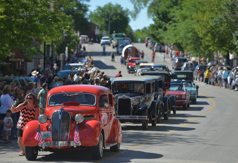 Justin Sheely | The Sheridan Press<br /> Classic cars continue down Main Street for the Longmire Parade Friday in Buffalo. 2016 marks the 5th year of Longmire Days for the town of Buffalo, which hosted several events involving the cast and members of the crew to meet their fans. Longmire started out on cable television in 2012 and is now a series on Netflix. The show follows the exploits of Sheriff Walt Longmire in fictional Absaroka County, Wyoming. The series is from local author Craig Johnson's books, who based the fictional town in his books on Buffalo, Wyoming.