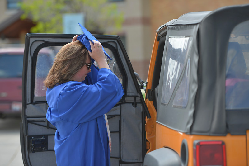 Justin Sheely | The Sheridan Press<br /> Melissa Horsley gets dressed in the parking lot prior to the 68th Commencement Ceremony Saturday at Sheridan College.