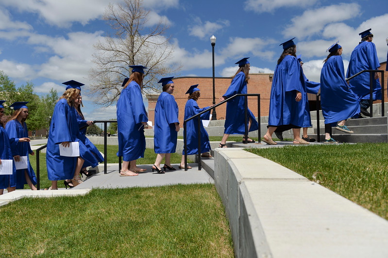 Justin Sheely | The Sheridan Press<br /> Graduates march to the Bruce Hoffman Golden Dome during the 68th Commencement Ceremony Saturday at Sheridan College.