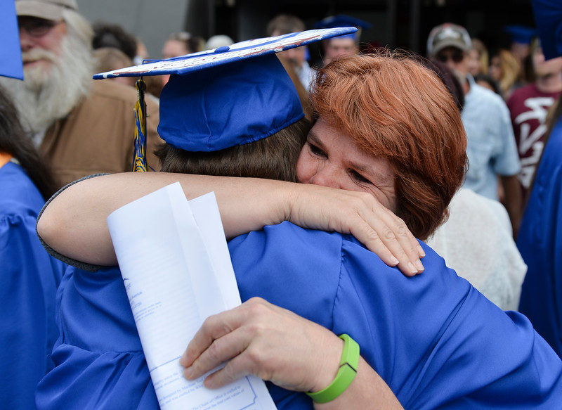 Justin Sheely | The Sheridan Press<br /> Dorinda Bechtell embraces her graduate son Joshua Bechtell during the 68th Commencement Ceremony Saturday in the Bruce Hoffman Golden Dome at Sheridan College.