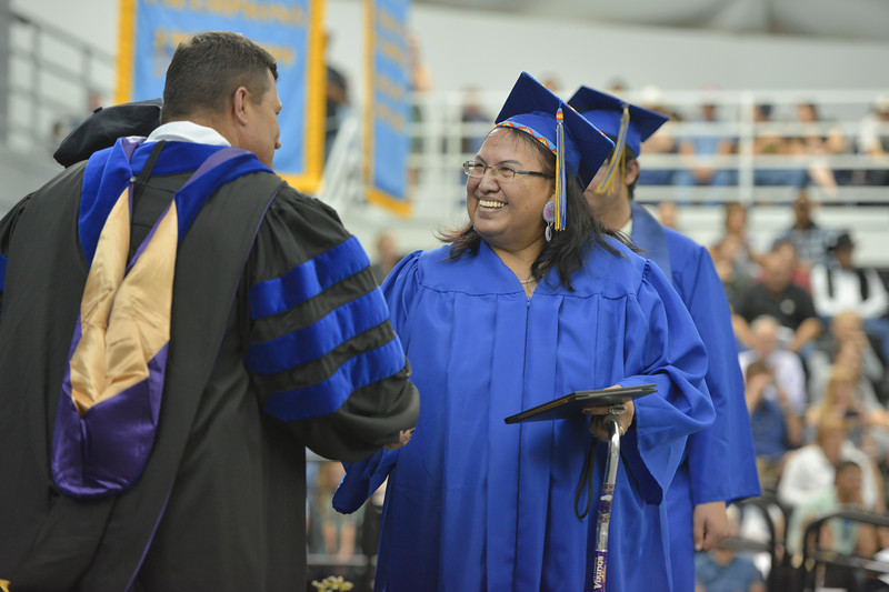 Justin Sheely | The Sheridan Press<br /> Evangeline Solis receives her associates during the 68th Commencement Ceremony Saturday in the Bruce Hoffman Golden Dome at Sheridan College.