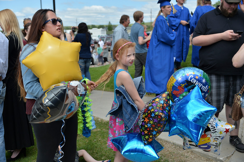Justin Sheely | The Sheridan Press<br /> Katherine Cloud and Jurnee Lowery wait outside for Lowery's graduating mother after the 68th Commencement Ceremony Saturday in the Bruce Hoffman Golden Dome at Sheridan College.