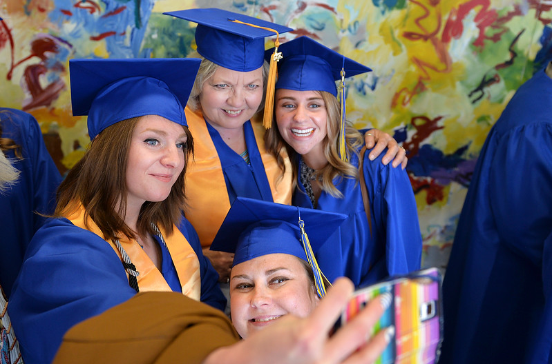 Justin Sheely | The Sheridan Press<br /> Criminal Justice graduates, from left, Kate Botten, Eileen Hurley, Sydney Reinking and Genevieve Lowery, below, pose for a selfie together prior to the 68th Commencement Ceremony Saturday at Sheridan College.
