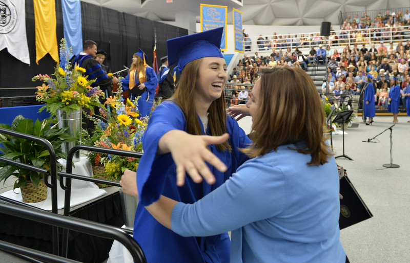 Justin Sheely | The Sheridan Press<br /> Graduate Ashley Gilmore is congratulated by Bobbi Mitzel during the 68th Commencement Ceremony Saturday in the Bruce Hoffman Golden Dome at Sheridan College.