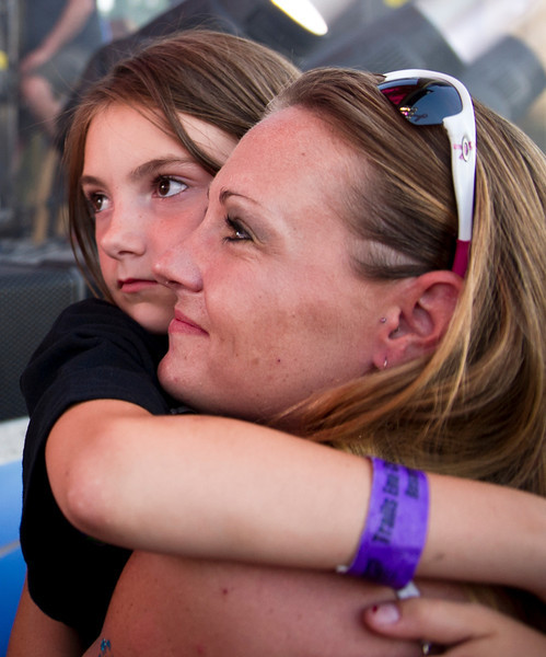 Tori Damuth holds her 8-year-old daughter Cadance Fouse next to the stage as Alan Jackson performs Sunday at the Trails End Concert Park.  (Justin Sheely/The Sheridan Press)