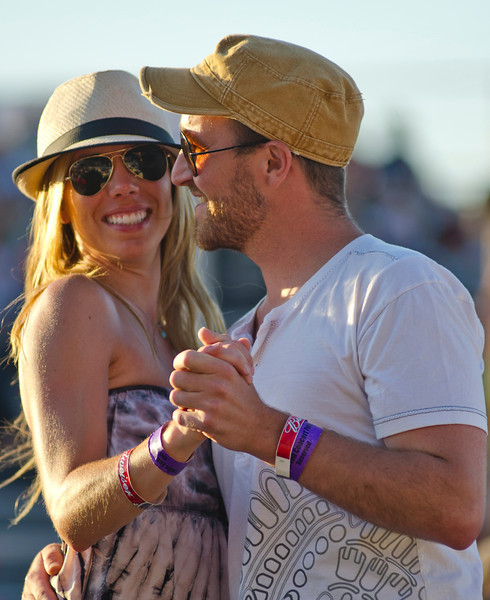 Natasha Potratz, left, and friend Daron Olson, of Billings, Mont., dance during Craig Campbell's opening performance at the Alan Jackson Concert Sunday at the Trails End Concert Park. (Justin Sheely/The Sheridan Press)