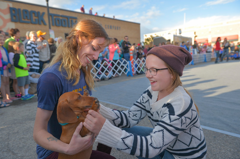 Justin Sheely | The Sheridan Press<br /> Casey Van Haele, left, and Emma Van Haele, 10, celebrate after Oscar wins the Aged Bratwurst class during Muddy Paw Prints' annual Wiener Dog Races Tuesday evening at Blacktooth Brewing Company.