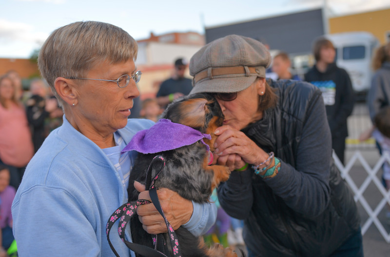 Justin Sheely | The Sheridan Press<br /> Kathy Kudsch holds Willow as owner Suzie Puckett gives a kiss before starting a heat during Muddy Paw Prints' annual Wiener Dog Races Tuesday evening at Blacktooth Brewing Company.
