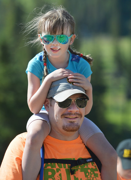 Justin Sheely | The Sheridan Press<br /> Antelope Butte Foundation volunteer Ryan White holds his daughter Finley White, 5, during the Summer Festival Saturday at Antelope Butte ski area. The Antelope Butte Foundation hosted a variety of live band performances, drinks, activities, camping and a number of bike and trail runs.