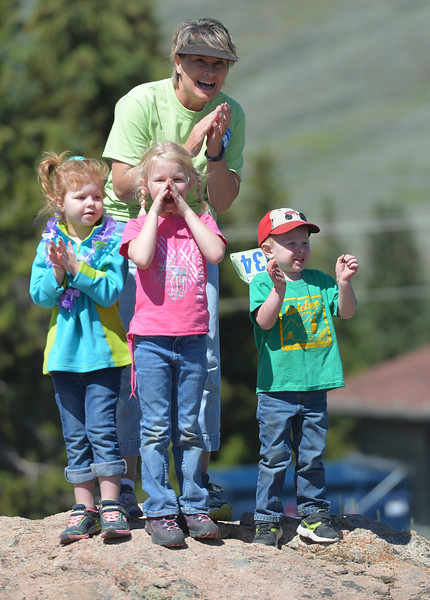 Justin Sheely | The Sheridan Press<br /> Cassie Wright and her grandchildren, from left, Ava Wright, Torrum Wright, 5, and Levi Wright, 3, cheer as runners cross the finish line during the Summer Festival Saturday at Antelope Butte ski area. The Antelope Butte Foundation hosted a variety of live band performances, drinks, activities, camping and a number of bike and trail runs.