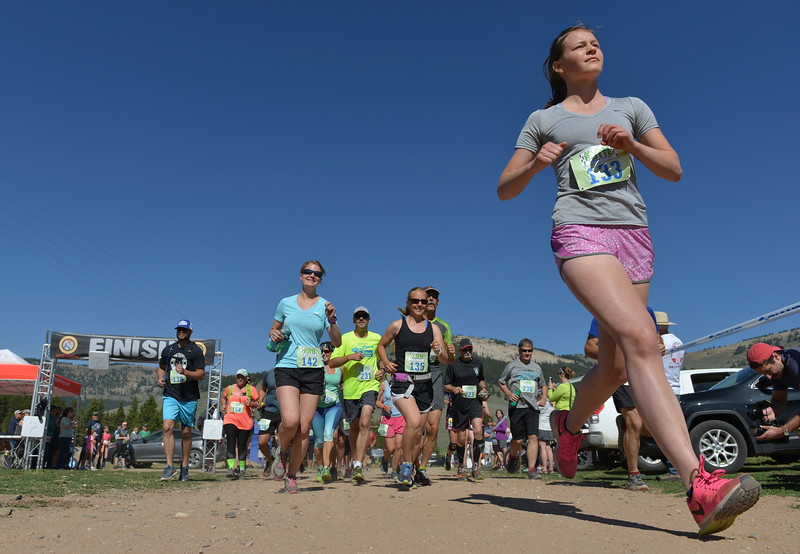 Justin Sheely | The Sheridan Press<br /> Clara Bouley and a group of 8-mile runners take off from the starting line during the Summer Festival Saturday at Antelope Butte ski area. The Antelope Butte Foundation hosted a variety of live band performances, drinks, activities, camping and a number of bike and trail runs.