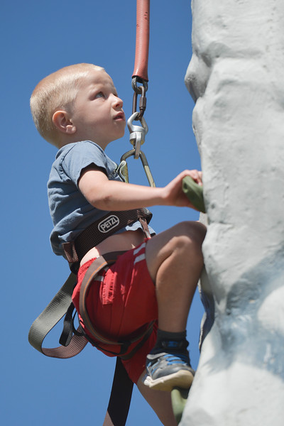 Justin Sheely | The Sheridan Press<br /> Five-year-old Liam Wisehart of Greybull climbs up the rock wall during the Summer Festival Saturday at Antelope Butte ski area. The Antelope Butte Foundation hosted a variety of live band performances, drinks, activities, camping and a number of bike and trail runs.