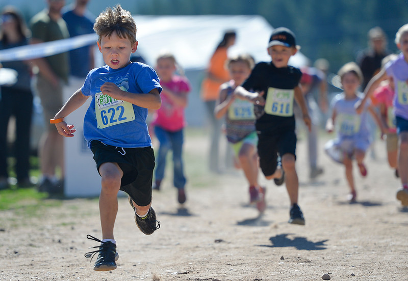Justin Sheely | The Sheridan Press<br /> Six-year-old Aleks Carroll runs in the children's race during the Summer Festival Saturday at Antelope Butte ski area. The Antelope Butte Foundation hosted a variety of live band performances, drinks, activities, camping and a number of bike and trail runs.