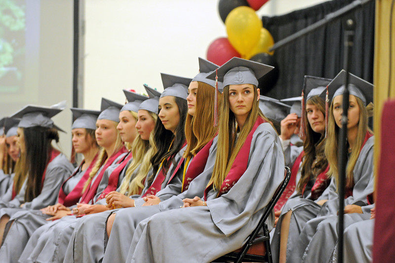 Big Horn valedictorian Eliza Beisher looks on as Rosie Berger speaks during the graduation ceremony on Sunday, May 28 at Big Horn High School. Mike Pruden | The Sheridan Press