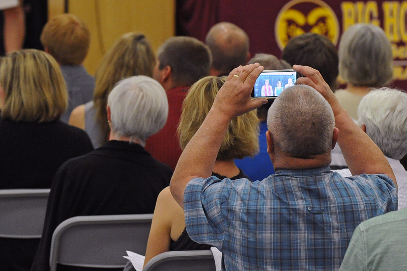 An attendee snaps a photo from his phone during the graduation ceremony on Sunday, May 28 at Big Horn High School. Mike Pruden | The Sheridan Press