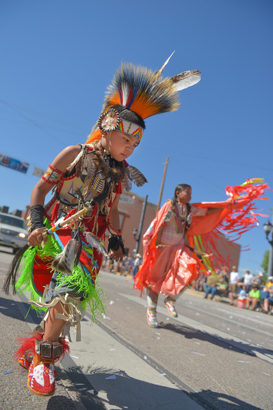 Justin Sheely | The Sheridan Press <br /> Herb Augustine, left, and Nala Augustine of the Winder River Reservation dance in the parade during the sixth annual Longmire Days Saturday on Main Street in Buffalo, Wyoming. The show is based on local author Craig Johnson's novels set in the fictional town of Durant, inspired by the town of Buffalo. Longmire's sixth and final season will be on Netflix sometime this year.