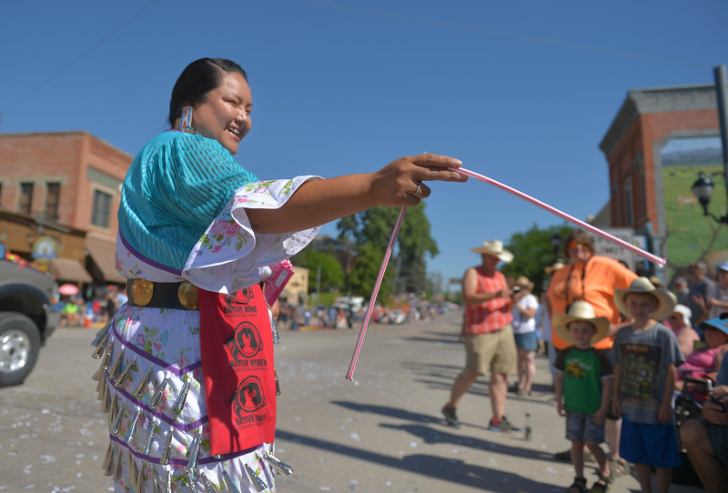 Justin Sheely | The Sheridan Press <br /> Jennifer Fragua of the Winder River Reservation offers candy in the parade during the sixth annual Longmire Days Saturday on Main Street in Buffalo, Wyoming. The show is based on local author Craig Johnson's novels set in the fictional town of Durant, inspired by the town of Buffalo. Longmire's sixth and final season will be on Netflix sometime this year.