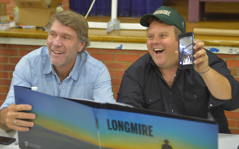 Justin Sheely | The Sheridan Press <br /> Longmire cast members Robert Taylor, Sheriff Longmire, left, and Adam Bartley, The Ferg, visit with fans during the sixth annual Longmire Days Saturday at the Bomber Mountain Civic Center in Buffalo, Wyoming. The show is based on local author Craig Johnson's novels set in the fictional town of Durant, inspired by the town of Buffalo. Longmire's sixth and final season will be on Netflix sometime this year.